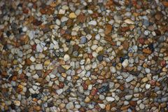 The structure of stones for the background. colorful stones in concrete, construction. for screen saver stock images
