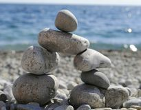 The structure of the stones on the beach. The stones by finding balance built arch at the pebble beach royalty free stock photos