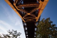 Structure under the bridge with tree and blue sky Royalty Free Stock Photography