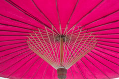 Structure under a pink umbrella Stock Photography