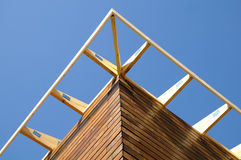Structure wood-three. Structure of a wooden house under construction, in French Royalty Free Stock Images