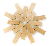 Structure of wooden bricks, looks like flower or sun Stock Photo