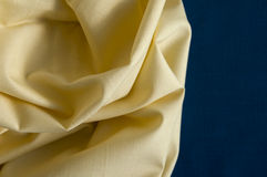 Structure of yellow cotton fabric on a blue fabric background Royalty Free Stock Photo
