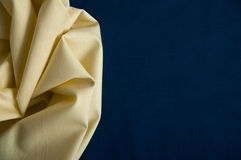 Structure of yellow cotton fabric on a blue fabric background Stock Image