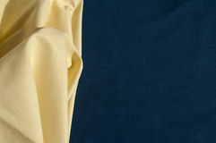 Structure of yellow cotton fabric on a blue fabric background Royalty Free Stock Image