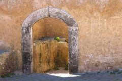 Gate in the fortification, El Jadida, Morocco. Structured facade of the wall with a gate with an arch and stone frame. Entrance to a room in fortification of El stock images