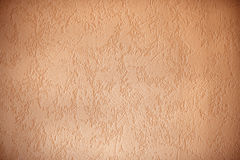 Structured wall surface with dark edges, apricot colored backgro Royalty Free Stock Photography