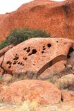 Structures and holes in Uluru Ayers Rock, Australia Stock Photography