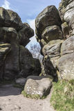 Structures at Brimham Rocks, North Yorkshire in England. Millstone grit rock structures forming a gap at Brimham Rocks, North Yorkshire, England, UK Stock Photos