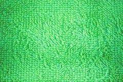 Structuur heldergroene handdoek voor een achtergrond Royalty-vrije Stock Foto