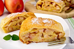 Strudel with apples in bowl on linen tablecloth Stock Photo