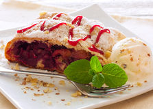 Strudel with apples and cherries Royalty Free Stock Images