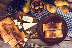 Strudel with cheese. And pear. Snack cake, strudel. Rural, rustic style Stock Images