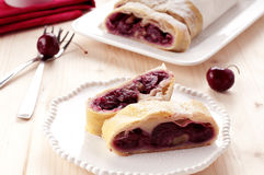 Strudel  with cherry. Homemade strudel with cherry and walnut Stock Photography