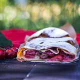 Strudel with a cherry. Cherry pie. Food on the nature. Summer cake. Pie, strudel with berries Royalty Free Stock Photo