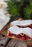 Strudel with a cherry. Cherry pie. Pie, strudel with berries  With winter decor. Cozy food. Winter, New Year's still life Royalty Free Stock Image