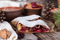 Strudel with a cherry. Cherry pie. Pie, strudel with berries  With winter decor. Cozy food. Winter, New Year's still life Royalty Free Stock Photos