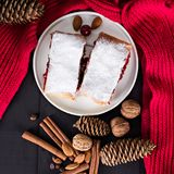 Strudel with a cherry. Cherry pie. Pie, strudel with berries  With winter decor. Cozy food. Winter, New Year's still life Stock Images