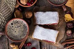 Strudel with a cherry. Cherry pie. Food on the nature. Pie, strudel with berries With autumn decor. Cozy food. Style rustic. Autumn still life Stock Photos