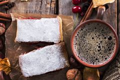 Strudel with a cherry. Cherry pie. Food on the nature. Pie, strudel with berries With autumn decor. Cozy food. Style rustic. Autumn still life Royalty Free Stock Photos