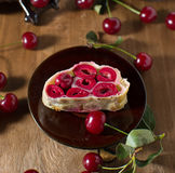 Strudel with cherry on paper napkin Royalty Free Stock Photo
