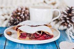 Strudel with a cherry. Cherry pie. Pie, strudel with berries  With winter decor. Cozy food. Winter, New Year's still life Royalty Free Stock Photo