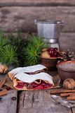 Strudel with a cherry. Cherry pie. Pie, strudel with berries  With winter decor. Cozy food. Winter, New Year's still life Royalty Free Stock Images