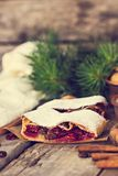 Strudel with a cherry. Cherry pie. Pie, strudel with berries  With winter decor. Cozy food. Winter, New Year's still life Royalty Free Stock Photography