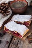 Strudel with a cherry. Cherry pie. Pie, strudel with berries  With winter decor. Cozy food. Winter, New Year's still life Stock Image