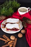 Strudel with a cherry. Cherry pie. Pie, strudel with berries  With winter decor. Cozy food. Winter, New Year's still life Stock Photography