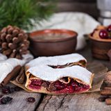 Strudel with a cherry. Cherry pie. Pie, strudel with berries  With winter decor. Cozy food. Winter, New Year's still life Stock Photo