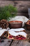 Strudel with a cherry. Cherry pie. Pie, strudel with berries  With winter decor. Cozy food. Style rustic. Winter, New Year's still life Royalty Free Stock Photography
