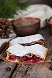 Strudel with a cherry. Cherry pie. Pie, strudel with berries  With winter decor. Cozy food. Style rustic. Winter, New Year's still life Stock Photos