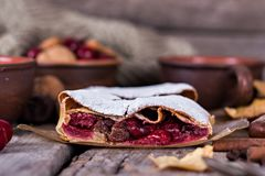 Strudel with a cherry. Cherry pie. Food on the nature. Pie, strudel with berries With autumn decor. Cozy food. Style rustic. Autumn still life Stock Images