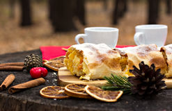Strudel with custard and orange. Christmas Stollen. Christmas table decoration Royalty Free Stock Images