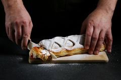 Strudel on dark background. baker cooking concept stock photography