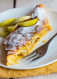 Strudel dessert with pears on a white plate, yellow, vertically Royalty Free Stock Photography