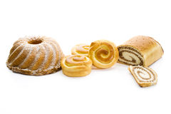 Strudel filled with nuts buns filled with cream ring cake on white background Royalty Free Stock Photos
