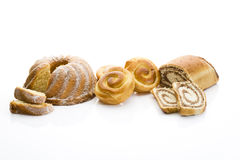 Strudel filled with nuts buns filled with cream ring cake on white background Stock Photography
