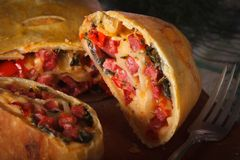 Strudel with ham, cheese and vegetables macro. horizontal Royalty Free Stock Photography