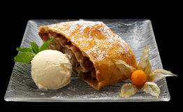 Strudel with ice cream. Austrian traditional cake strudel with ice cream on plate Royalty Free Stock Image