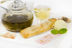 Strudel with ice cream and tea. Yellow Royalty Free Stock Image