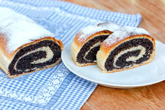 Strudel with poppy seeds on table Royalty Free Stock Photos