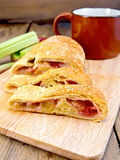 Strudel with rhubarb on wooden board Royalty Free Stock Image