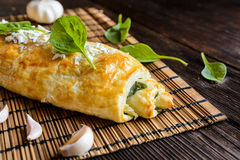 Strudel stuffed with spinach, cheese and garlic Royalty Free Stock Images