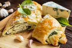 Strudel stuffed with spinach, cheese and garlic Royalty Free Stock Image