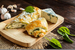 Strudel stuffed with spinach, cheese and garlic Stock Images