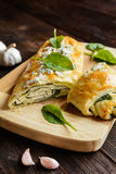 Strudel stuffed with spinach, cheese and garlic Stock Photos