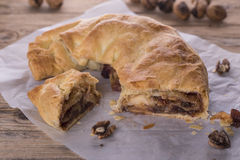 Strudel. Sweet puff pastry rolled stuffed with jam, dried fruit, nuts and apples Stock Image