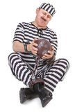 Struggle with ball and chain. Over white background royalty free stock photo